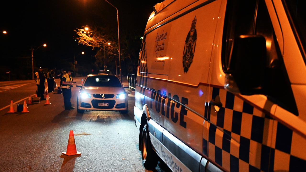 Police conduct roadside breath tests.