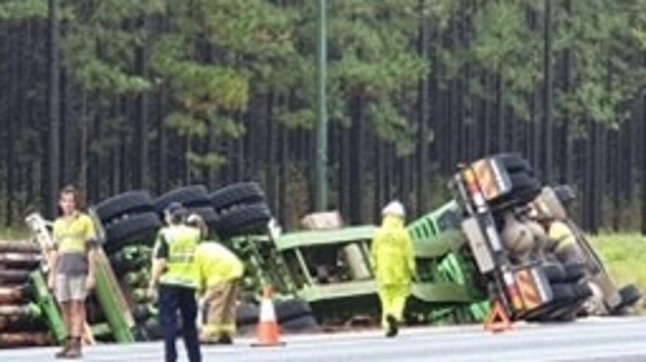 Logging truck rollover on the Tin Can Bay Road, Monday December 14, 2020