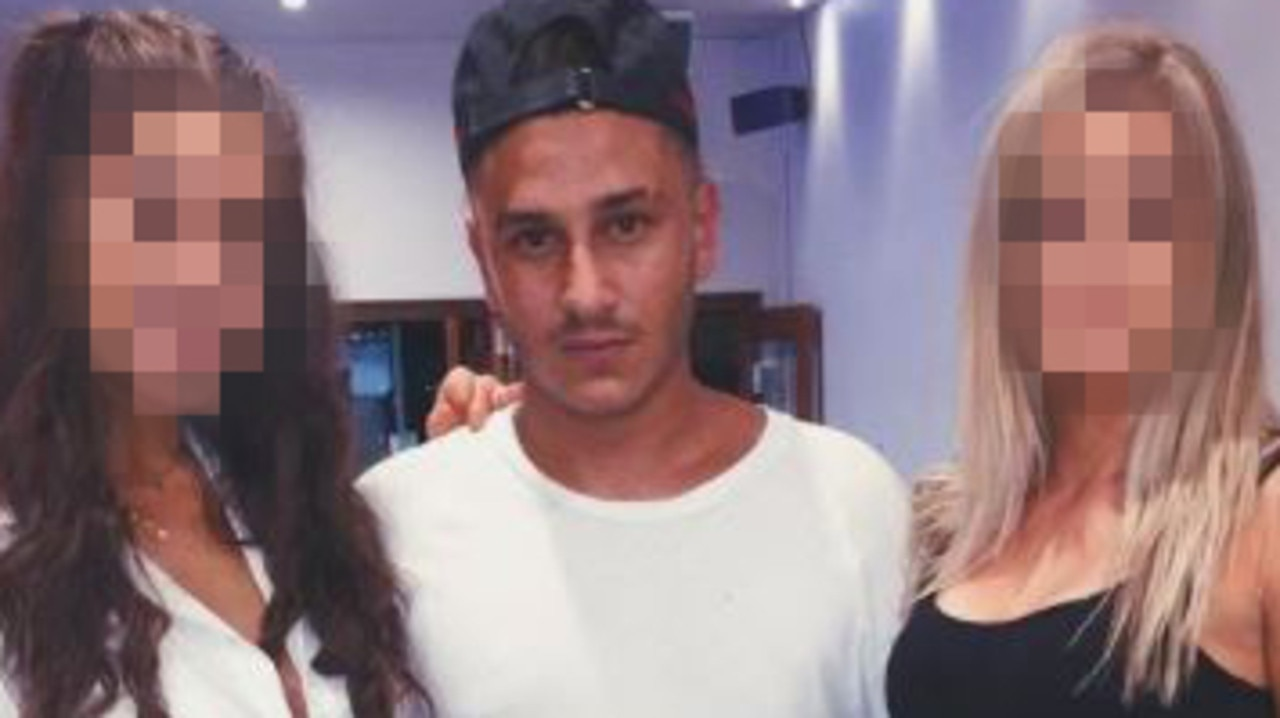 Insta-famous barber Michael Langanis poses with two women on his Instagram page. Picture: Instagram