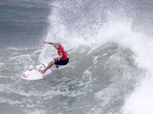 Groms thrive in big swell to grab surfing title