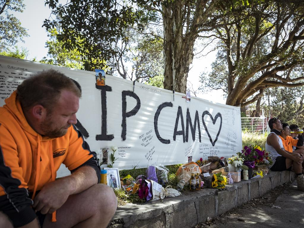 Friends and work colleagues mourn the death of Cameron Smith at a roadside tribute near the Seaford train station where he was killed. Picture: NCA NewsWire / Chris Hopkins