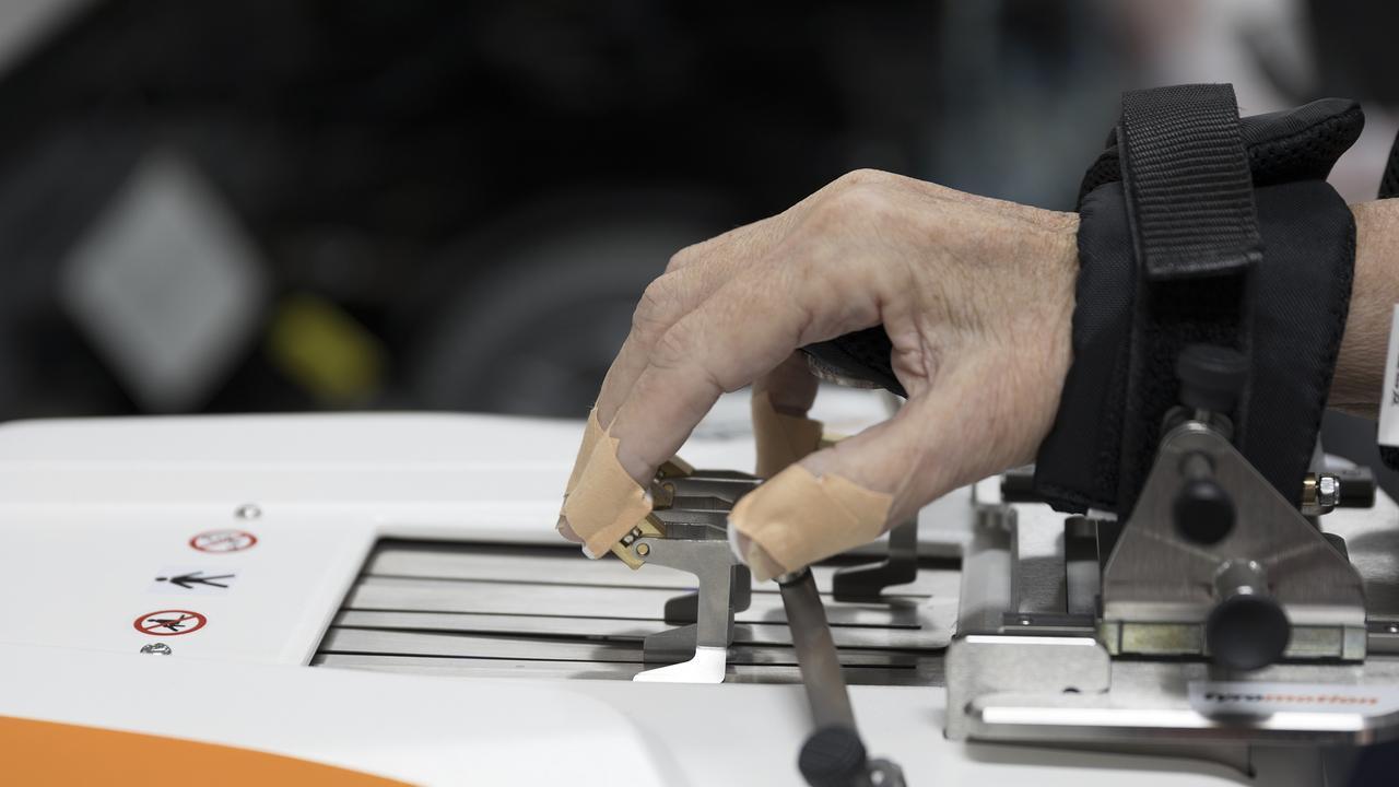 Jennifer Blackburn's hand using the equipment.