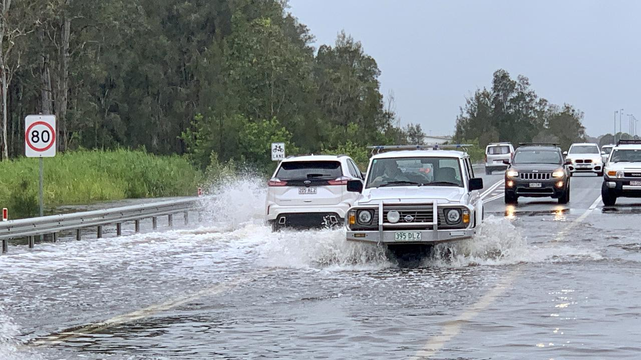 Motorists driving through the rain on David Low Way at Bli Bli. Picture: Patrick Woods