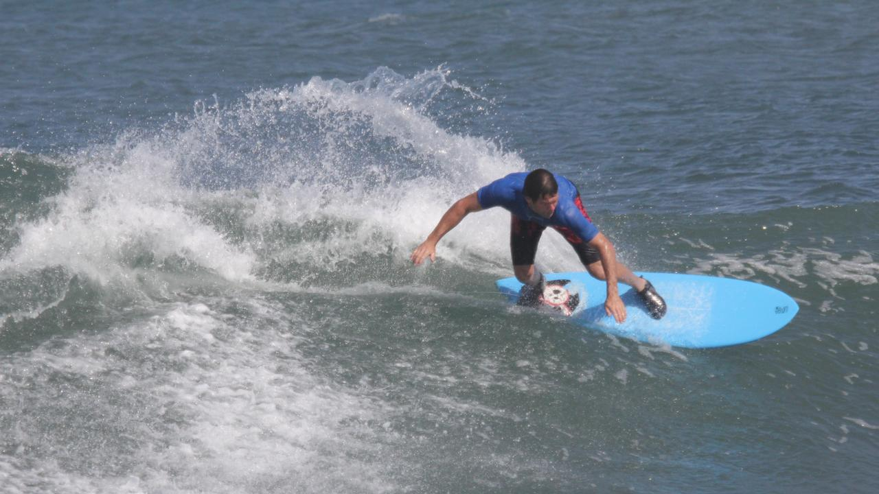 Ashley Ramage catching waves during a Bali surf trip in 2014.