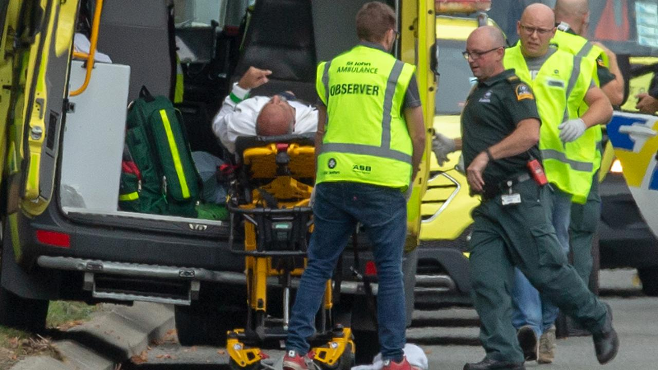 An injured person is loaded in an ambulance following a shooting at the Masjid Al Noor mosque in Christchurch. Picture: AAP