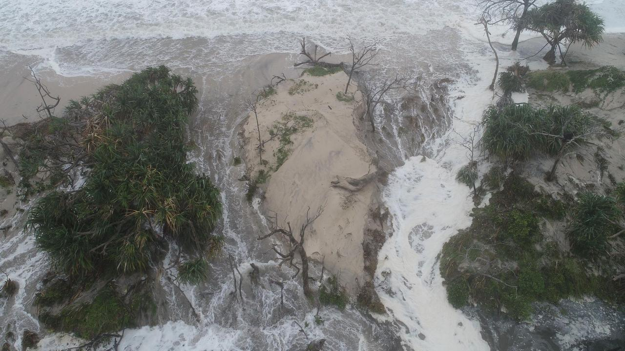 Caloundra resident Zane Jones has snapped this awesome drone footage of the big swell and high tides that caused Bribie Island to break through.