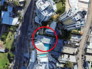 Roads closed in Surfers as glass falls from building