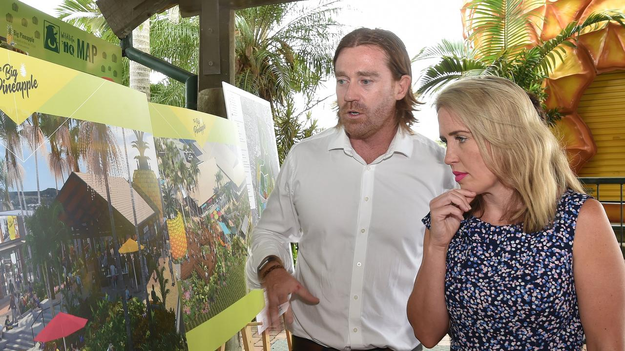 Former Tourism Minister Kate Jones announces the Queensland Government's support for the Big Pineapple Renewal Project in December 2019. She is pictured with project director Jim Costello.