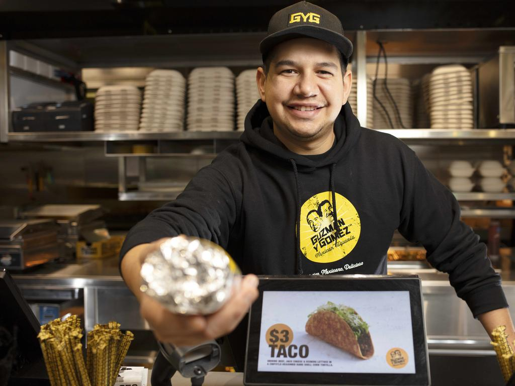 International student Miguel Reyes was able to secure a job at an OTR store where he is working in the Guzman y Gomez restaurant which means he can afford to continue to study in South Australia. Photographer Emma Brasier
