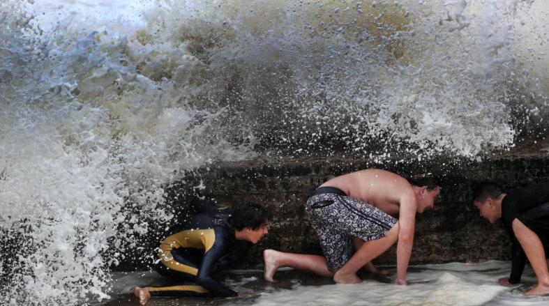 Big waves break over Snapper Rocks on the Gold Coast. Picture: NIGEL HALLETT
