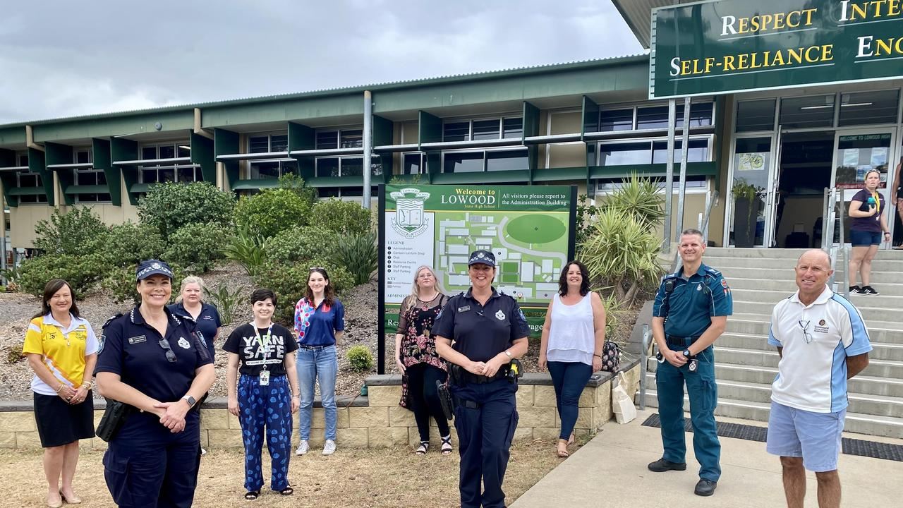 Sergeant Nadine Webster (centre) with drug action project team including paramedic Dwayne Simpson at Lowood State High School. Photo: Hugh Suffell