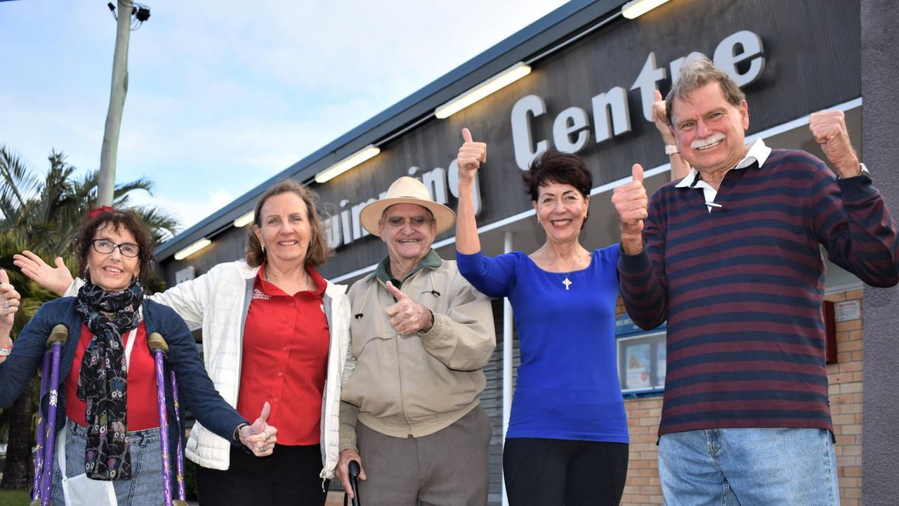 Mackay War Memorial Pool Community Action Group committee members (from left): Jane Conlon, Carol Single, Sue Willett and Graham Townsend with VC recipient Keith Payne (centre) at the front of the Memorial Swimming Centre which has just received state heritage listing. Picture: Heidi Petith