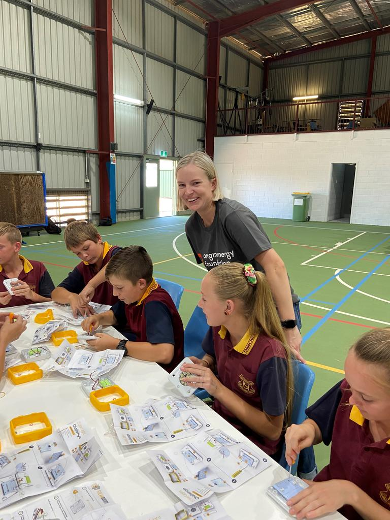 Students from Chinchilla State High School joined with volunteers from Origin Energy to build solar powered lights for children living in Papua New Guinea without electricity. Picture: Origin Energy Foundation