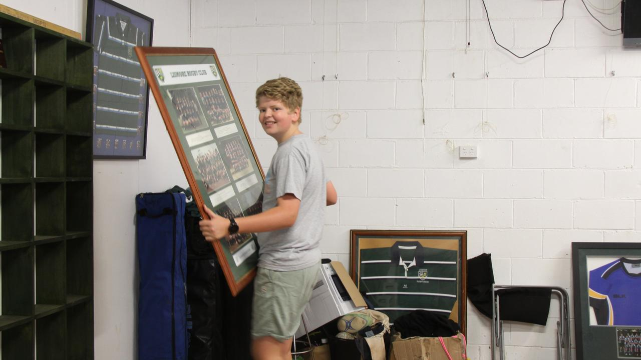 MANY HANDS: Lismore Rugby Union Club member Noah Tulk does his bit to carry out precious items from the clubhouse ahead of the expected flood. Alison Paterson