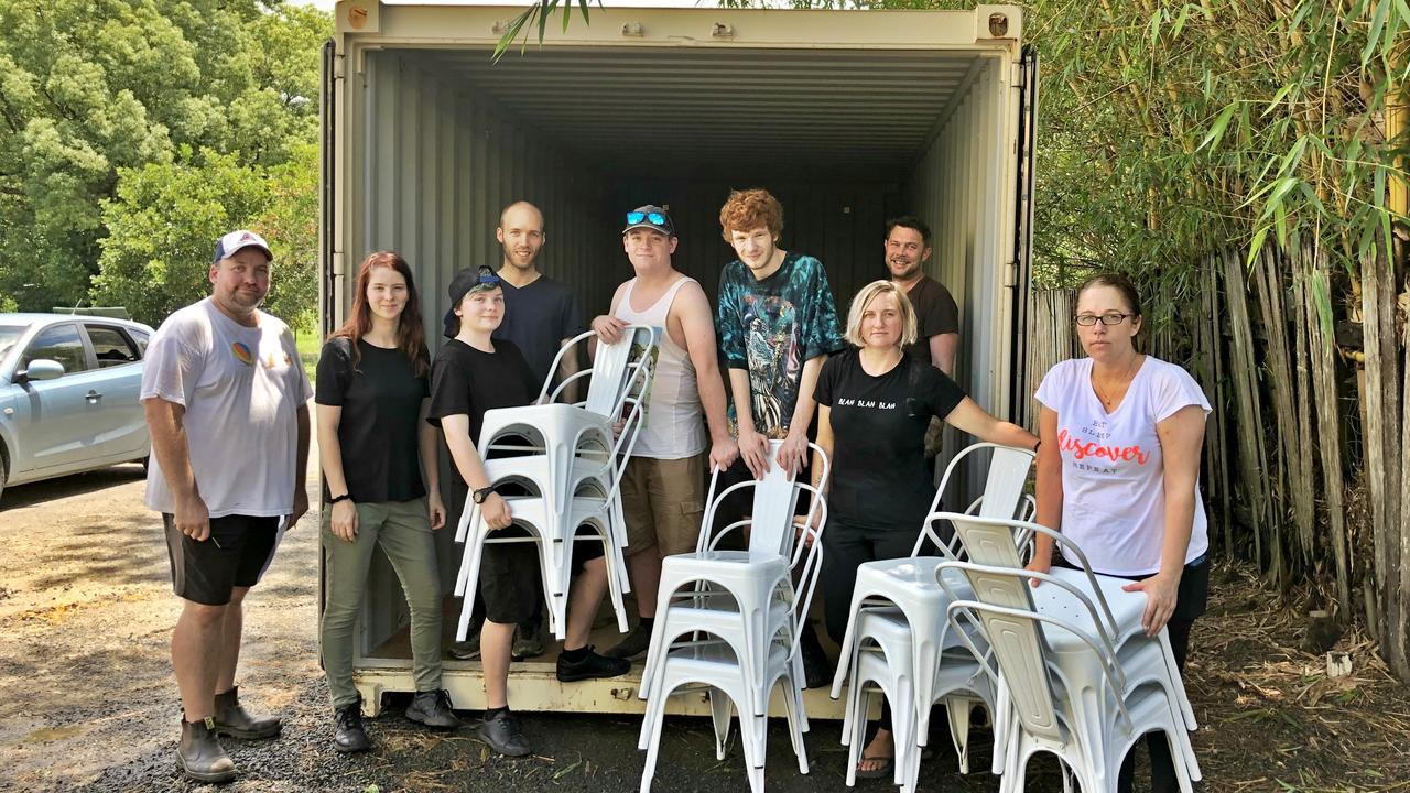BUMPING OUT: Rollerworld owners Crag and Belinda Newby with staff and friends are moving out as much of their stock and property as they can from their Lismore rollerskating rink ahead of the predicted flooding on Tuesday evening. Photo: Alison Paterson