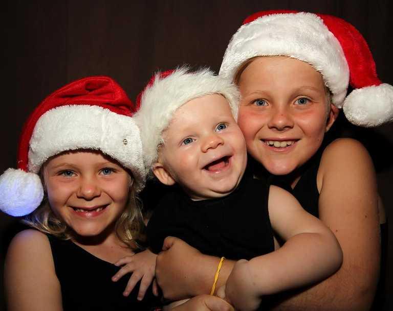 Milla, 6, Tanner, 1, and Boston, 8, at Mackay Christmas carols. Picture: David Clark