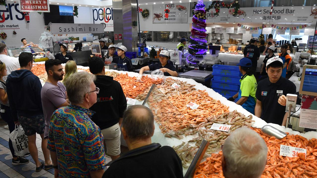 Large crowds buying their Christmas Day seafood during the annual 36-hour seafood marathon at Sydney Fish Market last year.