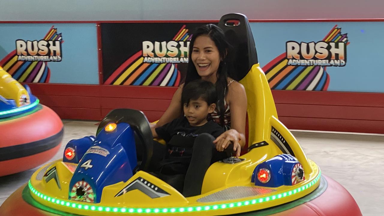 Irene Lahab and her son Joseph Makiri, 4, enjoy the new Rush Adventureland at Sunshine Plaza.