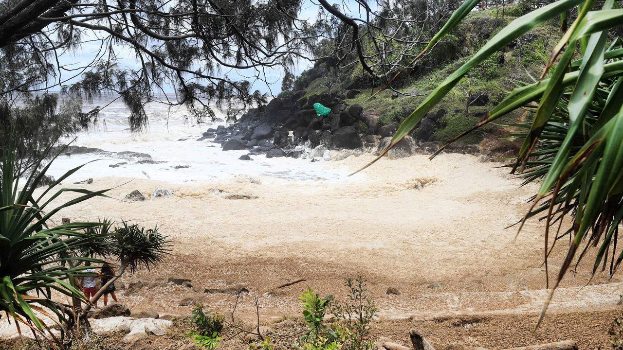 Little Froggies Beach at Snapper has also turned into a giant foam beach after the giant sea swell rolled in. Picture: Scott Powick/Newscorp