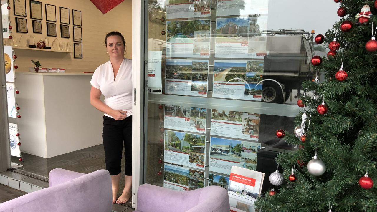 Rachael from Katrina Beohm Real Estate at the flooded East Lismore office.