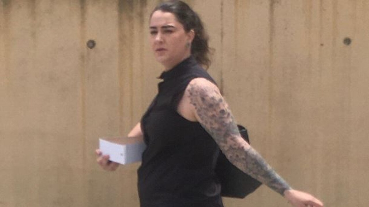 Jennae Jackson leaves court after admitting to slashing the tyres on three vehicles at one property, and stealing a dog from another.