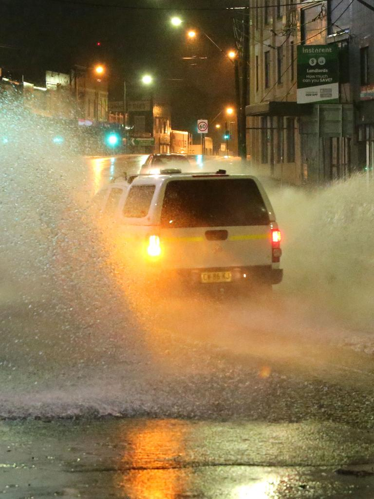 Constant rain caused roads to flood during the night. Parramatta Road at Five Dock and Taverners Hill overnight. Picture: Bill Hearne