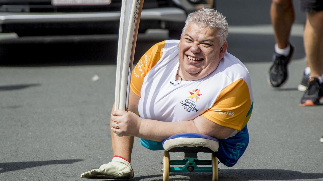 Baton Bearer John Coutis carrying the Queen's Baton in Surfers Paradise on the last day of the relay ahead of the official start to the 2018 Gold Coast Commonwealth Games.