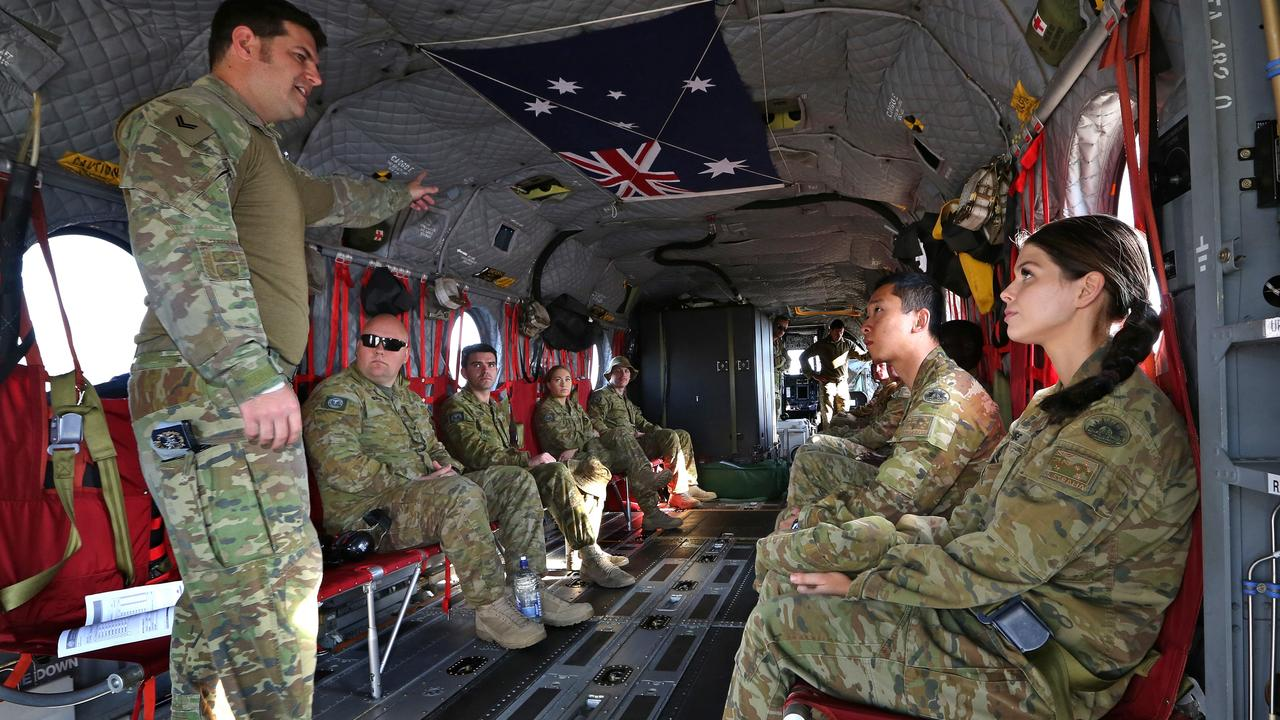 Australian Army soldier Corporal Ross Mead, an aircrewman from the 5th Aviation Regiment, delivers a safety brief to personnel of 9th Force Support Battalion before their flight on CH-47F Chinook during exercises last month. Picture: Defence