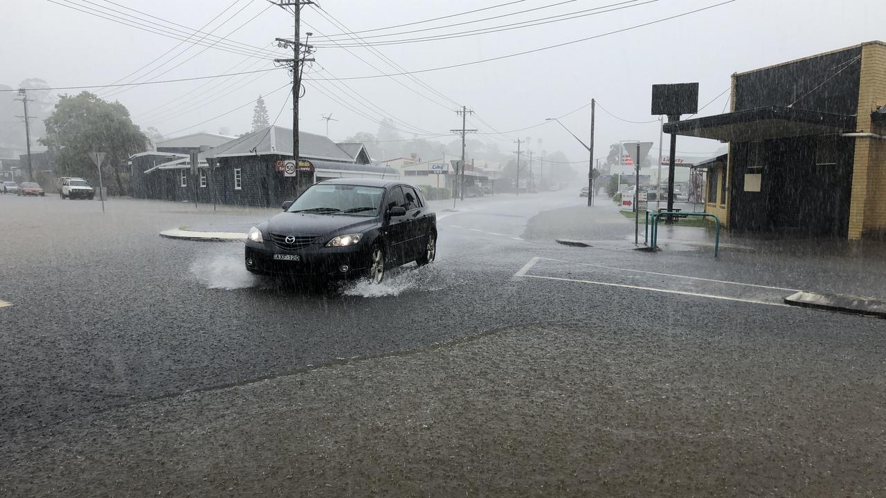 The northern lane of Wyrallah Rd is now closed after floodwaters have risen to threaten shops. Picture: Alison Paterson