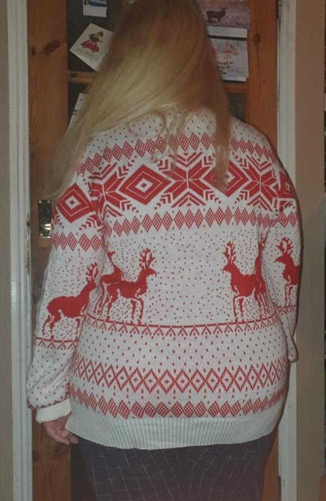 When she got home she realised the reindeer on her jumper appear to be having sex. Picture: Jam Press