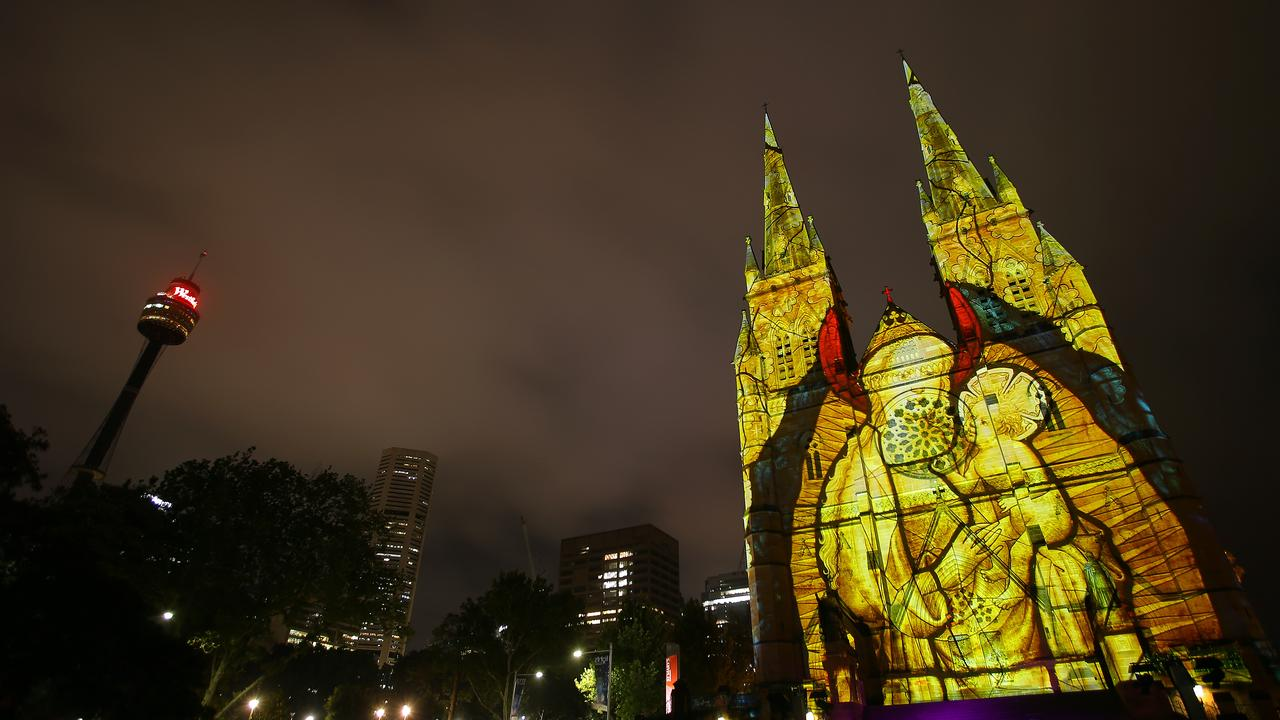 St Mary's Cathedral is illuminated with projections as part of Lights of Christmas in Sydney. Picture: AAP Image/Steven Saphore