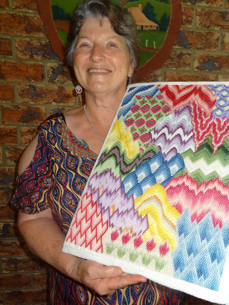 Sarina Arts and Crafts Centre board member Jenny Price with an intricate Bargello embroidery which she created at home during the COVID-19 shutdown. Picture: Charlie Payne