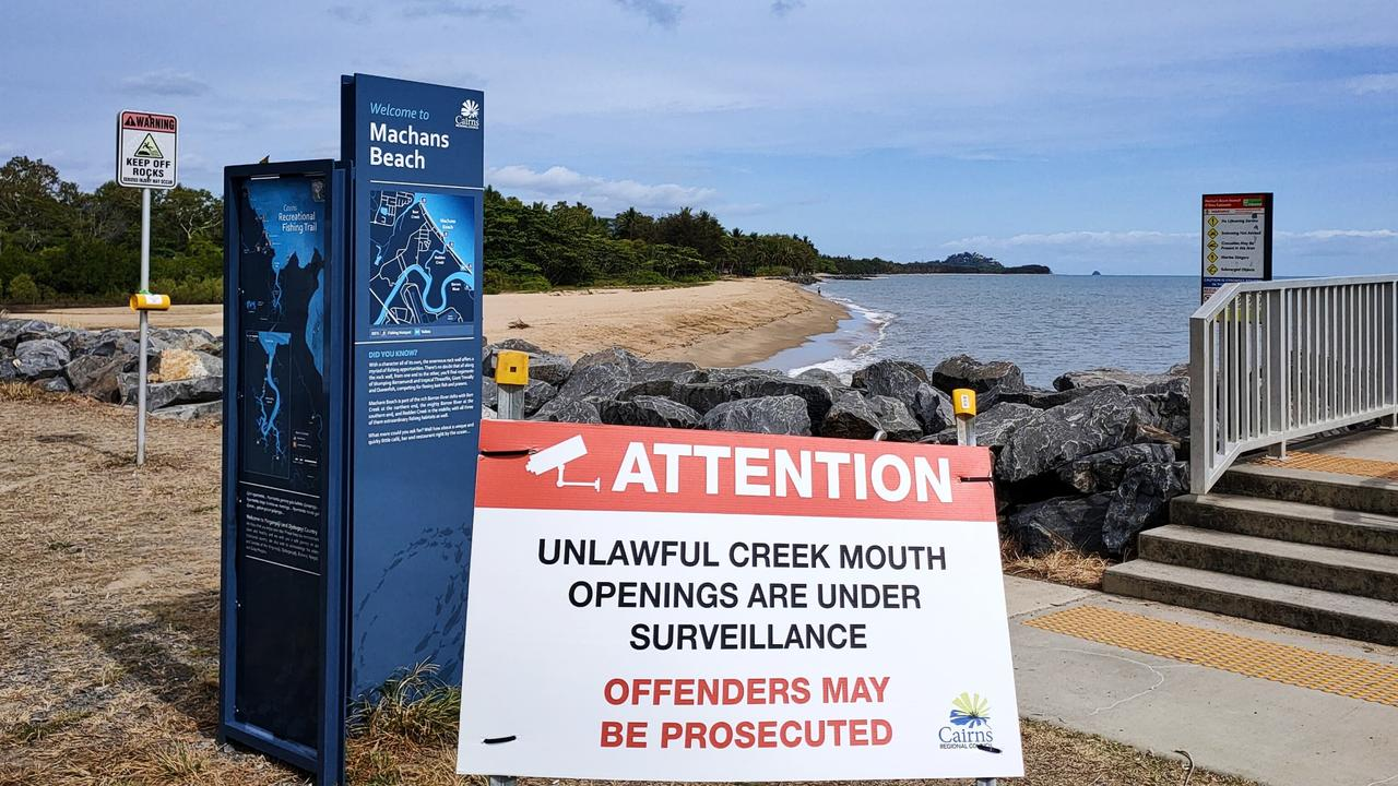 Cairns Regional Council signs warning of unlawful creek openings. Picture: Peter Carruthers