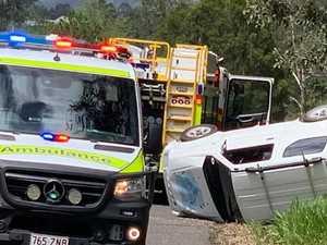 BREAKING: Woman in hospital after car flips on Gympie road