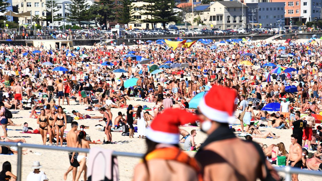 Beachgoers celebrate Christmas at Bondi Beach. Picture: AAP Image/Mick Tsikas