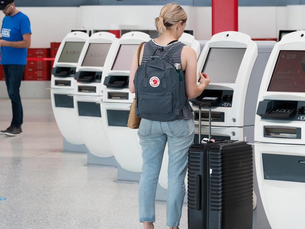 Qantas has called on their customers to use an app rather than contacting their besieged call centre to change flights. Picture: NCA NewsWire / James Gourley