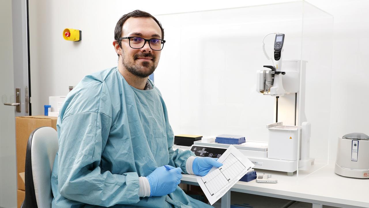 Laboratory Scientist Matt Hadaway monitoring Covid-19 testing plate at Sullivan Nicolaides Pathology, Brisbane. Picture: AAP Image/Josh Woning