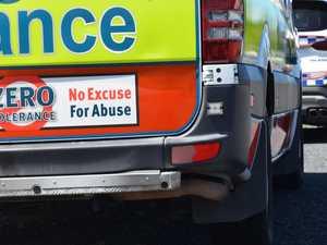 Paramedics assess three people as crash slows traffic