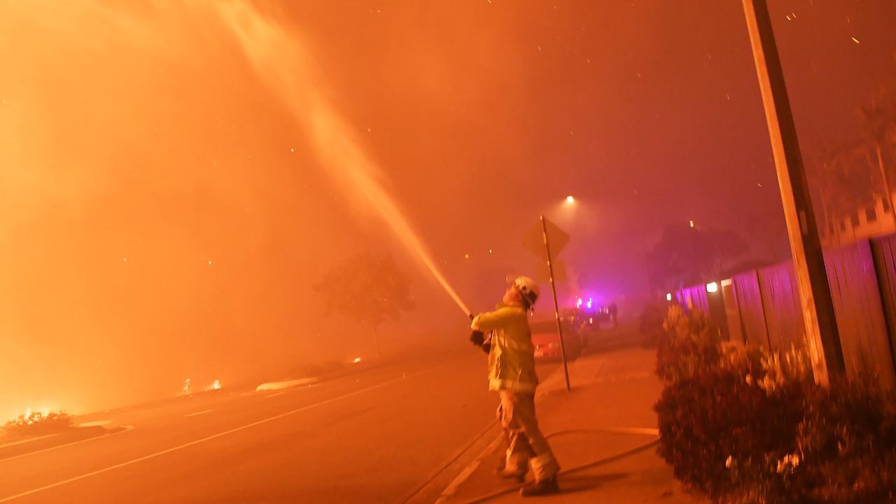 Firefighters on David Low Way, Peregian Beach in the 2019 bushfires. Photo Patrick Woods / Sunshine Coast Daily.