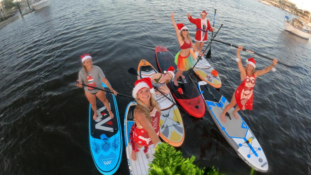 Brooke Rogers, Kylie Gretener, Sam Mallinder, Susanne Breeze and Nicole Ramsey spread Christmas cheer during a themed stand up paddle on the Mooloolah River. Picture: Supplied.