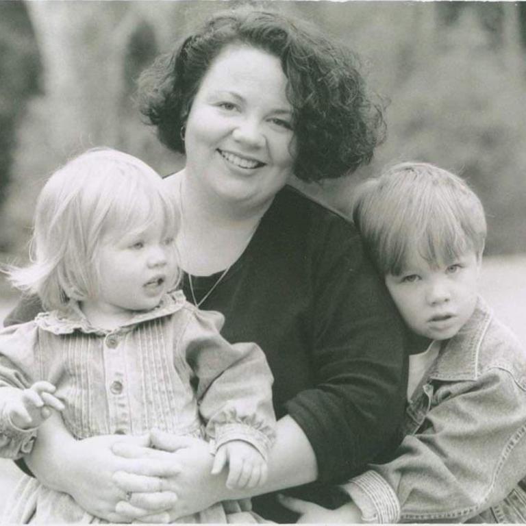 Mum Kate Yates with Matheson (left) and Josh (right).