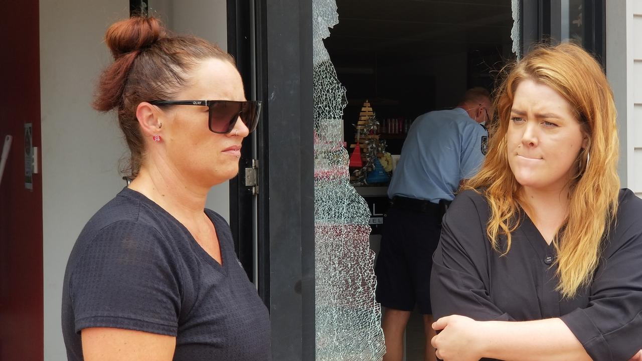 Pie Guru worker Chemene Bailey and Sol Hair Lounge owner Demika Simpson survey the damage to their businesses. Picture: Timothy Cox