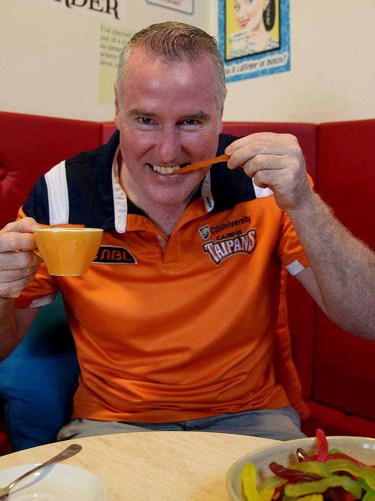 Taipans CEO Mark Beecroft enjoys a snake with his coffee at Bang n Grind. Picture: Marc McCormack.