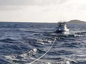 Yeppoon coast guard tows cruiser at sunrise