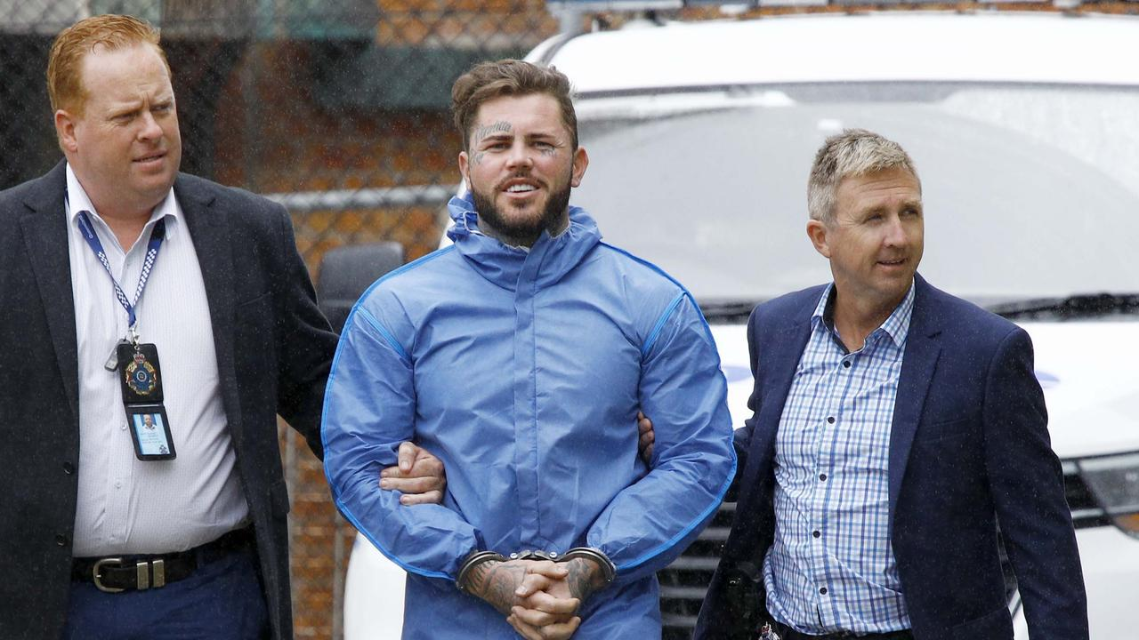 Ben Geppert being walked into the Southport Watchhouse after his arrest. Picture: Tertius Pickard.