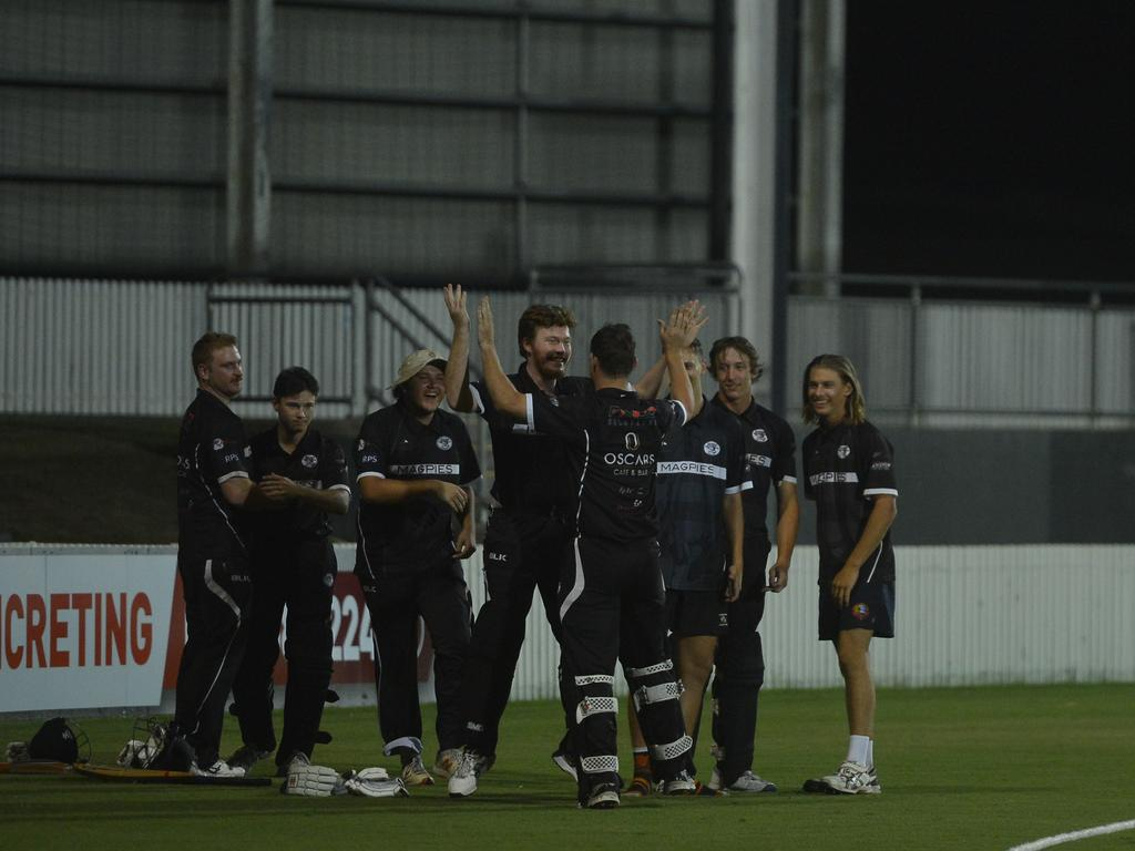 Magpies players celebrate after Isaac Borg hits the winning runs against Norths in the Dixon Homes Div 1 T20 Shootout grand final. Photo: Callum Dick