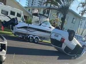 Car flips onto roof after hitting parked boat