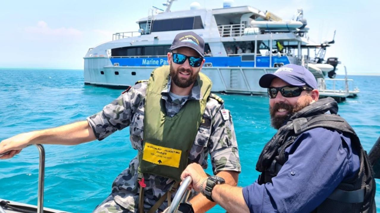 Australia Defence Vessel Cape Inscription Navigation Officer Lieutenant Rhys Worboys and Great Barrier Reef Marine Park Authority officer Dwaine Butcher in front of Reef Ranger, a Queensland Parks and Wildlife Service vessel. Picture: Contributed