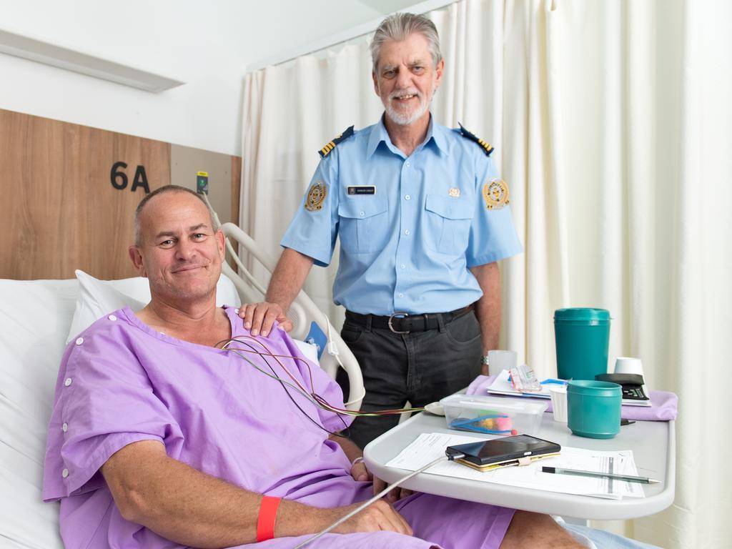 Survivor Chris Newlyn with VMR skipper Charles Linsley at Mackay Base Hospital.