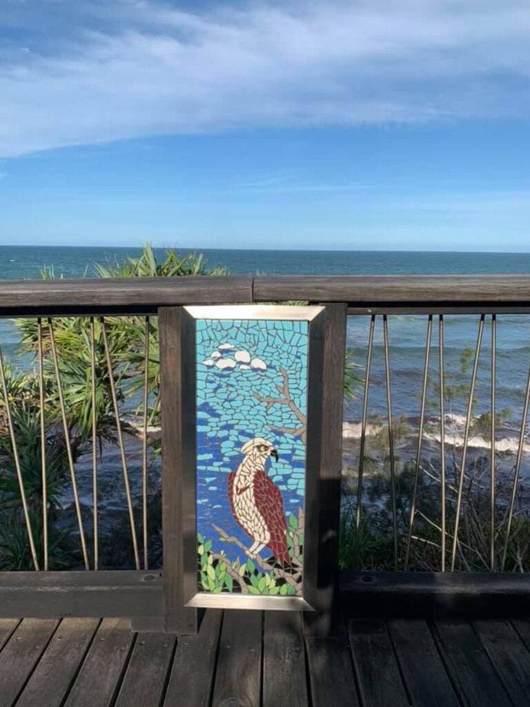 Local not-for-profit organisation Coolum HeARTs' mosaic class created 10 mosaics that were installed on the Coolum Boardwalk's bollards on Monday. Picture: Supplied